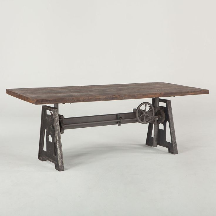 Recycled wood and iron have been fused together in a contemporary design with a rustic twist. The Industrial Loft Dining Table is an eclectic and fully functional piece of furniture that has been craf