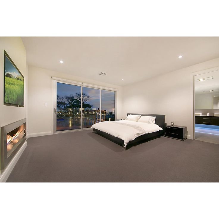 Main bedroom design, with a stunning view and gas heating to keep you cosy during #Adelaide cold winter nights - Custom Build by Serenity Homes #custombuild #buildingdreams #home #cosy #interior #bedroom