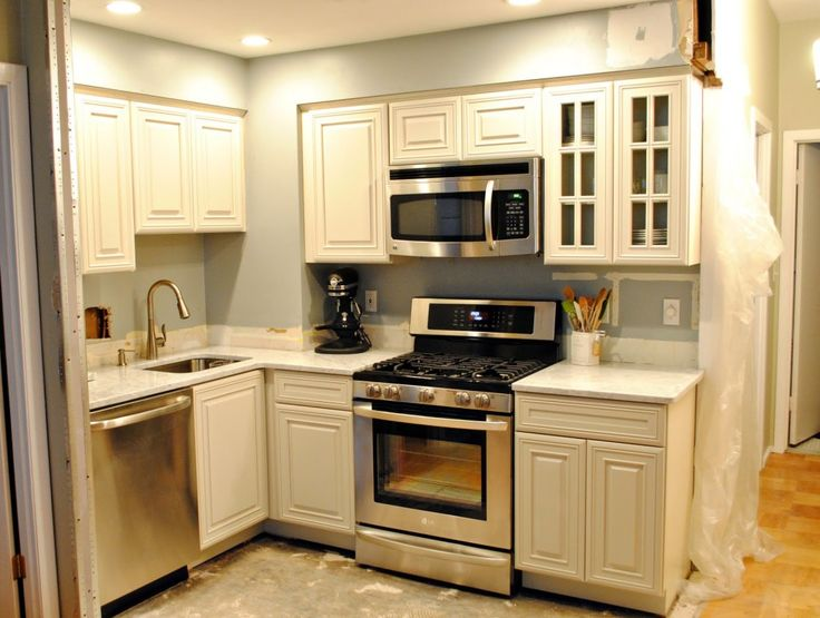 Small Kitchen. White Cabinets.