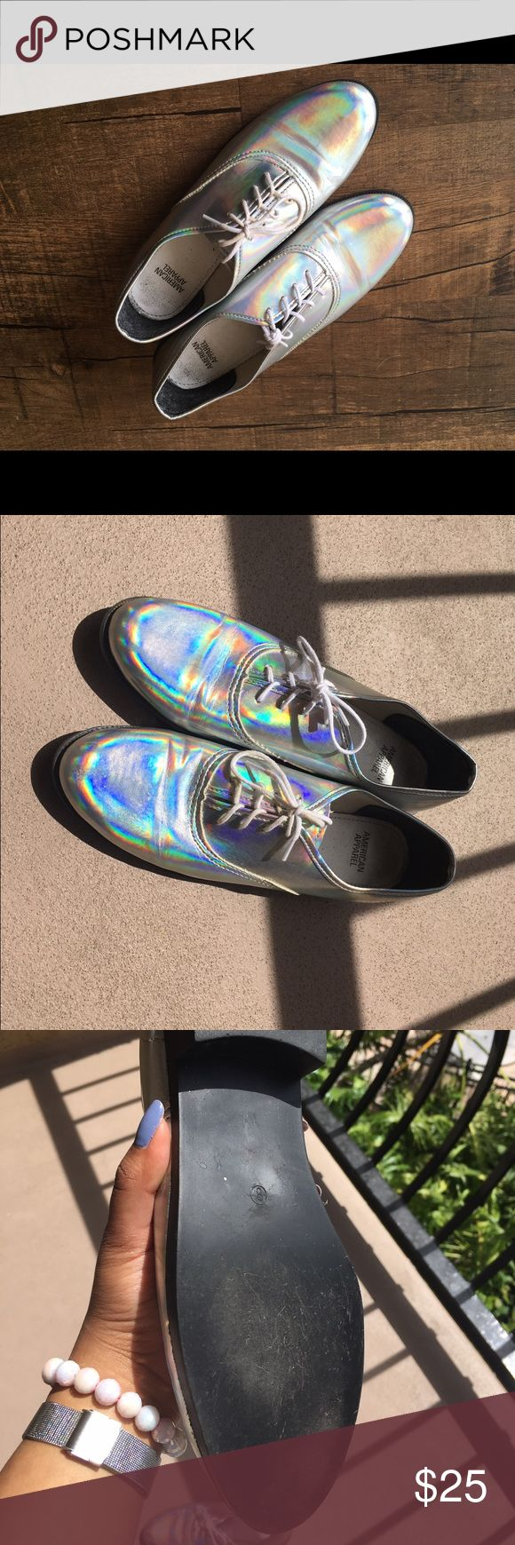 American Apparel iridescent holographic Oxfords American Apparel size 8 oxford shoes. Small 1 or 3/4 inch heel. I was looking for these for the longest time but American Apparel doesn't sell half sizes and they're too big :( I ordered them anyway obviously. Good condition. VERY iridescent; they don't need to be in a certain lighting for others to see the colors. Silver base color. American Apparel Shoes Flats & Loafers