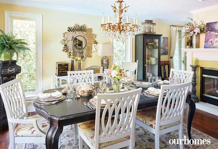 "A crystal chandelier, fine china and informal white painted chairs mixed with a traditional dining table create an eclectic dining scape.    See more of this home in ""Elora Homeowners Add Character in Spades"" from OUR HOMES Wellington-Dufferin Summer 2017: http://www.ourhomes.ca/articles/build/article/elora-homeowners-add-character-in-spades"