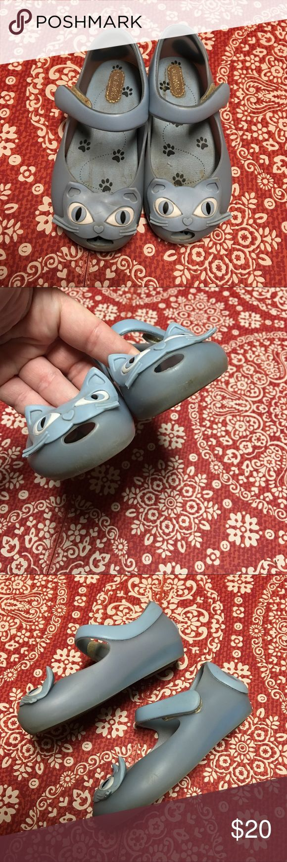 Mini Melissa blue cats Authentic Mini Melissa blue cats. Do show signs of wear as shown in pics (including broken whiskers). Play condition. Have several other pairs listed in size 9- check them out! * Sorry- the Mini Melissa shoes will not be included in the BOGO FREE sale * Mini Melissa Shoes