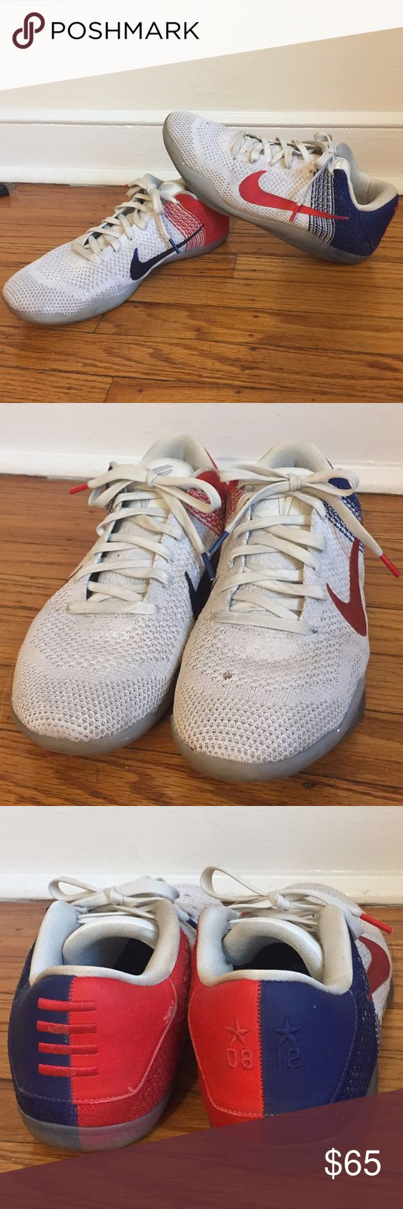 Nike Kobe Elite 11 Low Nike Kobe 11 Elite low men's basketball sneakers. Red white and blue colors, but the white is a little dirty as shown. A few other flaws as shown in the pictures. Smoke free home. Nike Shoes Sneakers