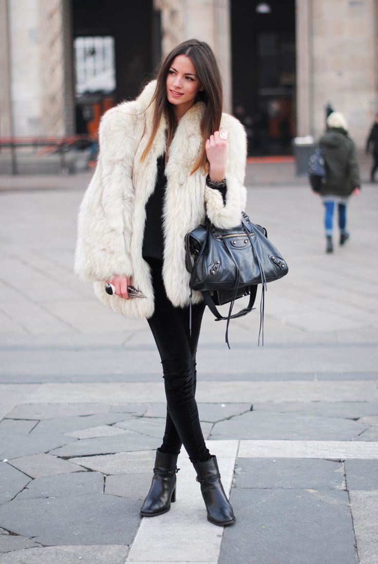Don't know her, but she is some fashonista at a fashion week and rocking a NICE huge fox fur coat.