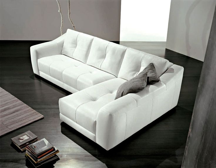 aidahomes.com wp-content uploads 2015 01 sweet-l-shaped-white-leather-sofa-design-with-dark-cushions-and-brown-carpet-or-black-living-room-floor.jpg
