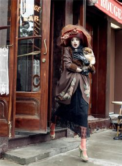 """mote-historie: """"  Agyness Deyn in John Galliano, Photo by Steven Meisel, """"Paris, Je T'aime"""", Vogue US, The September Issue, 2007. John Galliano mink-trimmed, floral embroidered coat and kid gloves, Chanel brooch, velvet and tulle hat by Stephen Jones..."""