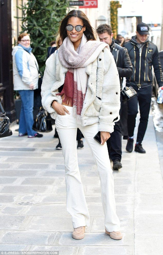 Layered up: Cindy donned a multi-coloured scarf and mirrored sunglasses...