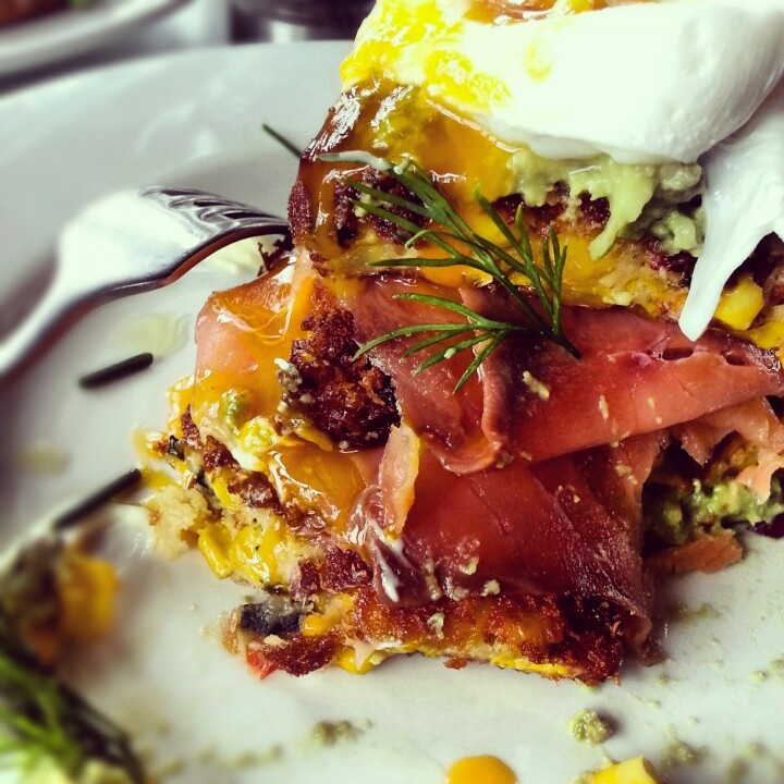 NSHRY, Albert Park  Panko crumbed corn fritters with smoked salmon and avocado, topped with a poached egg.