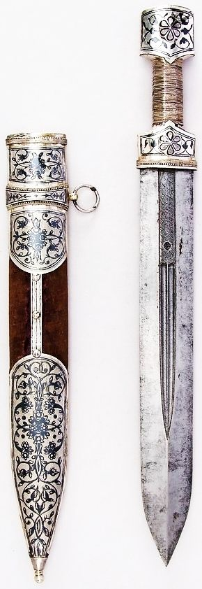 Qama (ca. 18th-19th Century CE Caucasian Weapon) (1935, Bequest of George C. Stone, Met Museum) | Steel, silver, niello, textile, silver wire L. with sheath 18 3/4 in. (47.6 cm); L. without sheath 17 1/4 in. (43.8 cm); W. 1 15/16 in. (4.9 cm); Wt. 14.6 oz. (413.9 g); Wt. of sheath 7.7 oz. (218.3 g)
