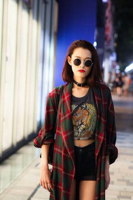 oversized plaid / tartan shirt worn as cardigan + crop top + black denim shorts + round lennon style sunglasses /// 90s grunge outfit