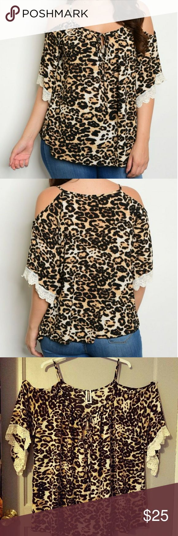"""Plus size cold shoulder animal print top Plus size cold shoulder animal print top Plus Size Scoop Neckline Cold Shoulder 3/4 Flutter Sleeve Animal Print Top, With Lace Detail.   98% polyester 2% spandex 1x underarm to underarm 25"""" underarm to hem 18"""" 2x underarm to underarm 26"""" underarm to hem 18"""" Tops"""