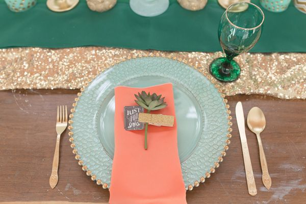 coral aqua place setting - photo by Cannon Candids Photography http://ruffledblog.com/coral-and-emerald-wedding-inspiration