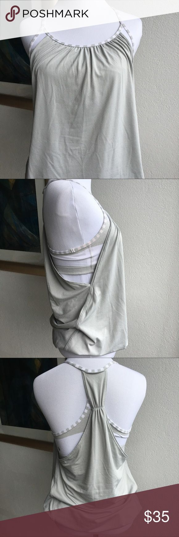Lululemon Gray White No Limit Top size 6 Preowned authentic Lululemon Gray White No Limit Top size 6. Builtin bra, no pads. Please look at pictures for better reference. Happy shopping! lululemon athletica Tops Tank Tops