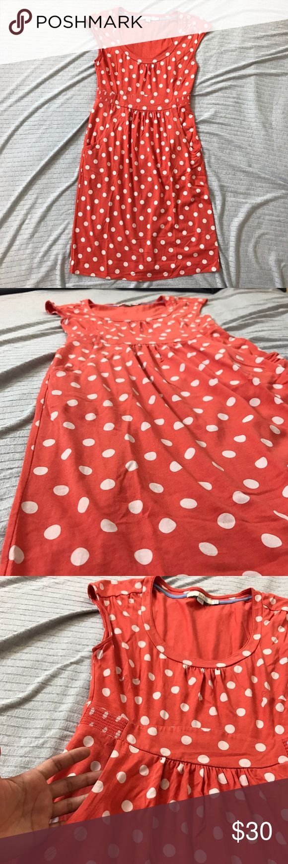 Boden Coral & White Polka Dot Dress This is a casual weekend dress from Boden. It is a coral pink with white polka dot pattern. It has front pockets, a scoop neck and short sleeves. The knit jersey material has stretch. Armpit to armpit is 15 in, waist is 13.5, hips 17.5 in. length is 36 in. (712) Boden Dresses Midi