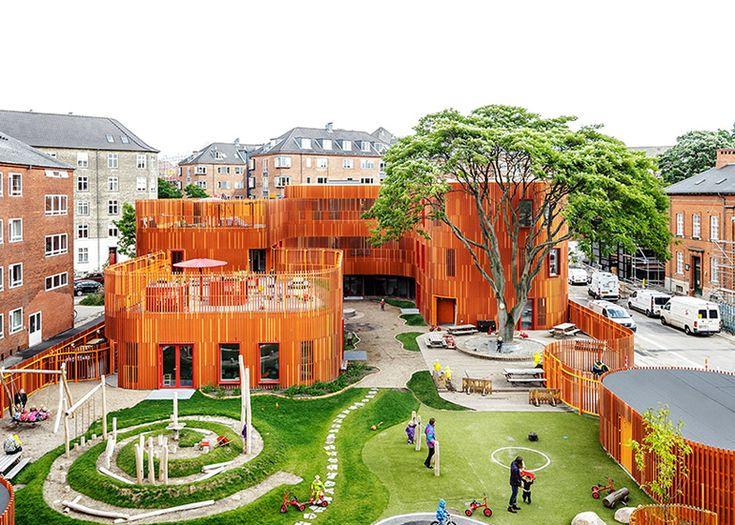Vertical strips of masonry wrap around the buildings and playgrounds that make up Forfatterhuset Kindergarten, a new preschool in Copenhagen by Danish studio COBE