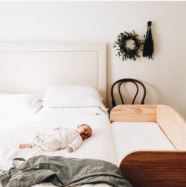 I know that the focus of this pic is the baby and the sidecar crib, but I love the headboard on that bed. Gorgeous!