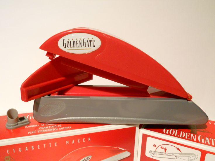 Aparat de injectat tutun Golden Gate - este un aparat manual pentru injectat tutun in tuburi tigari; culoare injector: rosu cu gri; se foloseste pentru tuburi tigari de lungime standard. Pentru comenzi si alte detalii: www.tuburipentrutigari.ro