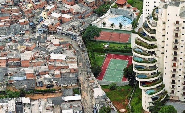 This picture is a great example of Social Difference. You can see that the rich are on the right and the poor are on the left. This also shows social stratification which is a further defining of a social structure. It is about social class and what people have to own determines where they fall in that class.