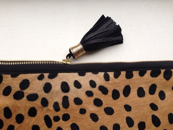 I'm OBSESSED over my Providence Story 11.5 x 11.5 Cheetah Print Fold Over Clutch