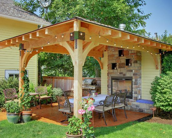 This covered patio would fit perfect on the concrete slab between the house and workshop