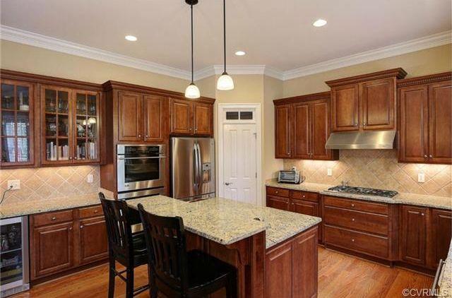 Craftsman Kitchen with 38-Bottle Stainless Steel Wine Refrigerator, Rainier 1-Light Mini Pendant, Jacob counter stool, Flush