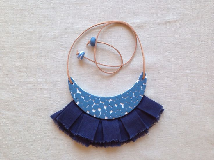 Mary Ted Creative - Handmade statement necklace from clay with blue dot detail, linen fringing and leather strap.