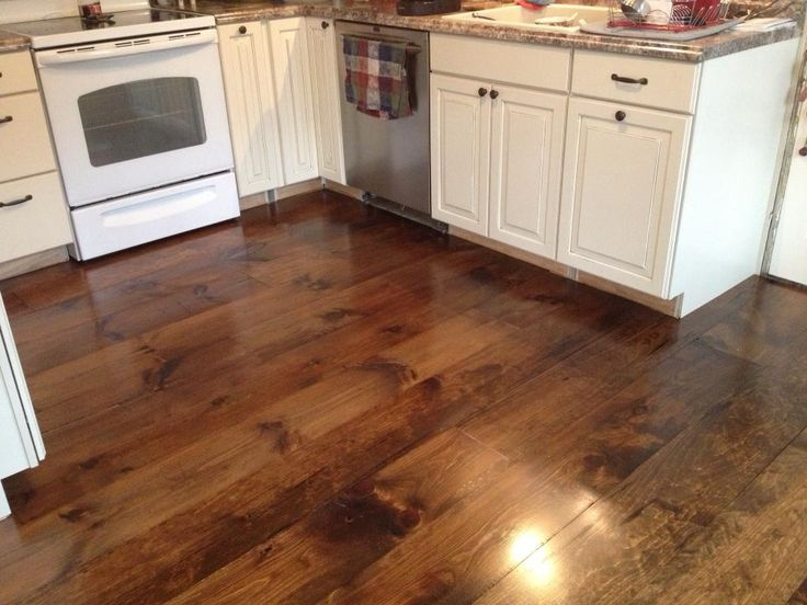 """""""...with a little elbow grease and TLC, we have a beautiful floor. Just beware, this wood is SOFT. It will dent and mar, but that's the look we were going for in our 1850's farmhouse."""" Rustic & natural, White Pine is perfect in this kitchen!"""