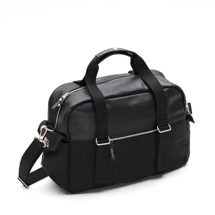 NEW! - QWSTION - OVERNIGHTER - BLACK LEATHER - The Overnighter offers a classic look in a compact format with highly contemporary style, while offering an ample amount of versatility and organization. With a built in laptop compartment, iPad storage, multiple zippered storage pockets and multiple carrying options this bag can go with you anywhere.
