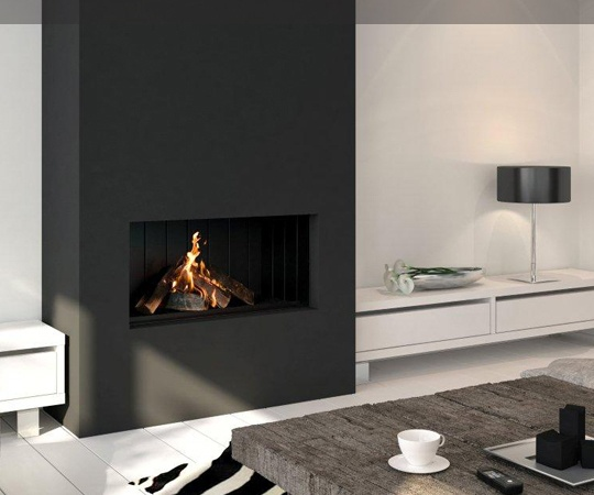Fire place and built-in storage with room for tv on shelf.