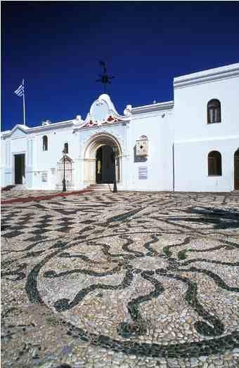 Panagia Evangelistria legendary Church courtyard made of pebbles, Tinos Island , Greece