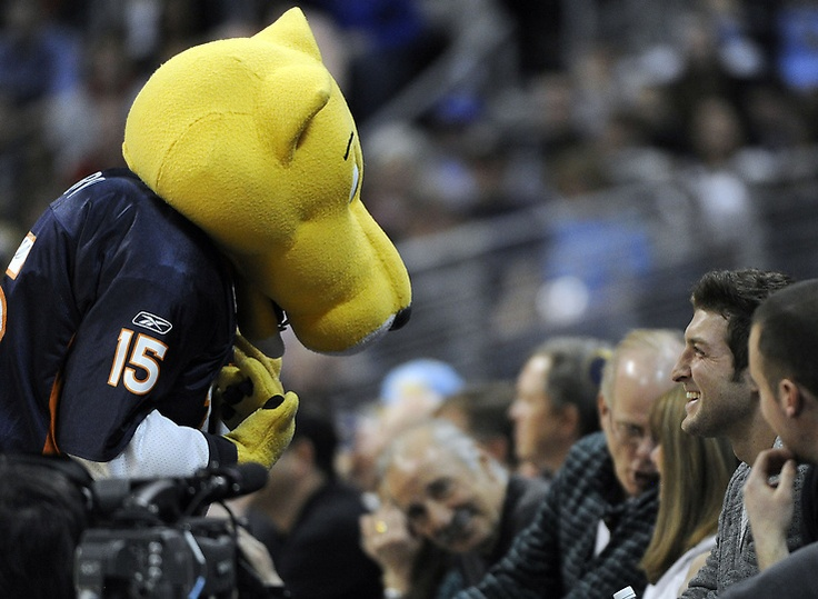 Tim Tebow with Rocky in a Tebow Jersey at Nuggets vs. Clippers 01-29-12
