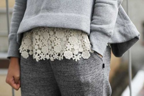 Sew vintage lace to the bottom of a sweatshirt.