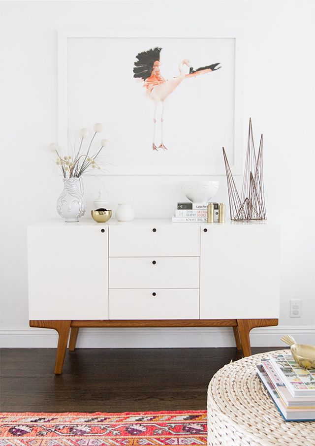 The modern buffet doubles as a minimal entryway credenza with plenty of storage space!