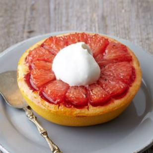 Brown Sugar Broiled Grapefruit - Grapefruit for dessert? Why not! In this broiled grapefruit recipe, grapefruit halves are topped with spiced brown sugar, caramelized under the broiler then topped with a dollop of vanilla-infused whipped cream.