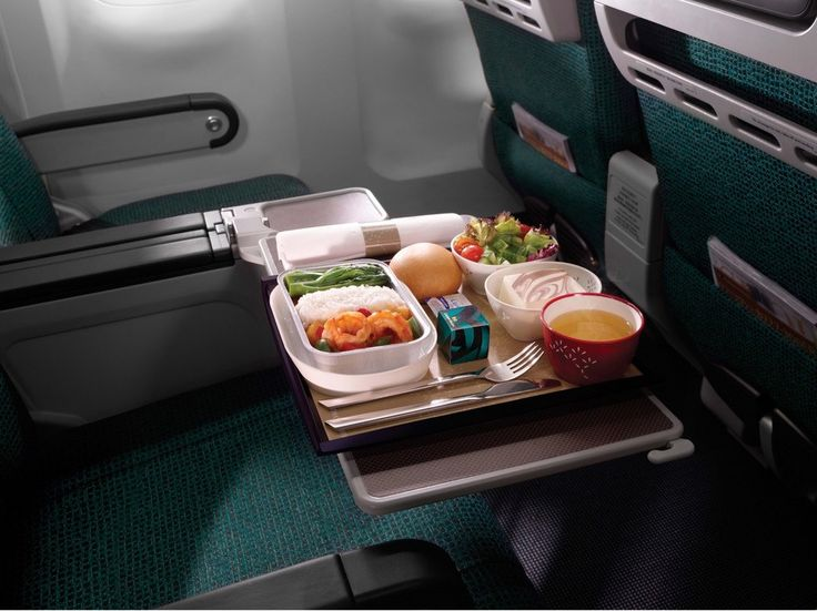Every trip on Cathay's Premium Economy cabin starts with a hot towel and a glass of bubbly (or juice, if you so prefer), hinting at the enhanced food service for the flight (including tasty meals and a variety of snacks). The seats, which have an eight-inch recline, end on either legrests (if you're in the front row) or three-position footrests. Amenities like noise-canceling headphones, fancy bathroom soaps, eco-friendly amenities, and the oversized pillows add to the luxurious experience.