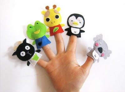 No patterns but cute felt finger puppet ideas and there are more on the site