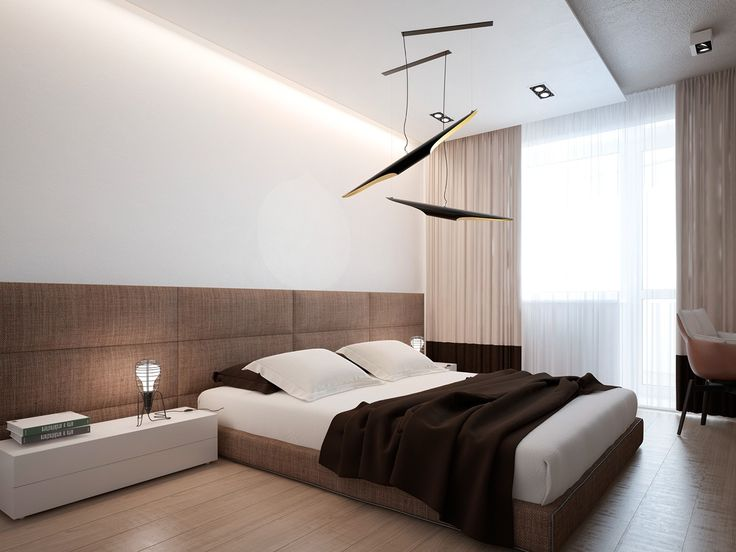 The bedroom includes a chocolate brown duvet and creative ceiling mounted mobile, giving a nod to Voytov's artistic pursuit of sculpture. In the mast bath, an angular tub, elevated from the rest of the room is a bit of simple, modern luxury.