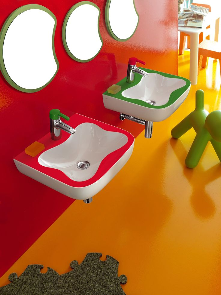 The Flower shaped wash basin lies at the heart of the concept with matching Florakids single lever mixer with powder-coated lever in red and green, children's hands can grip and operate safely.