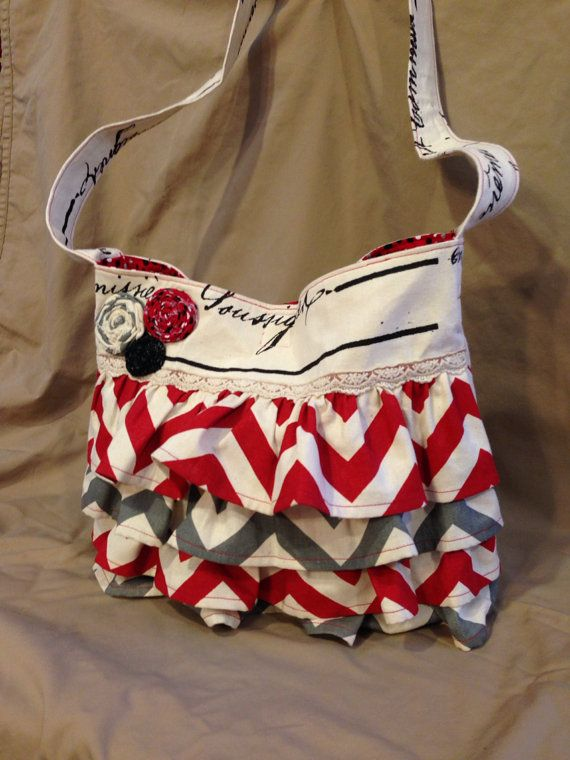 Red and Grey Chevron Purse with 6 pockets. OMG I want tHIS so bad!!!!! If anyone wants to buy this for me lol