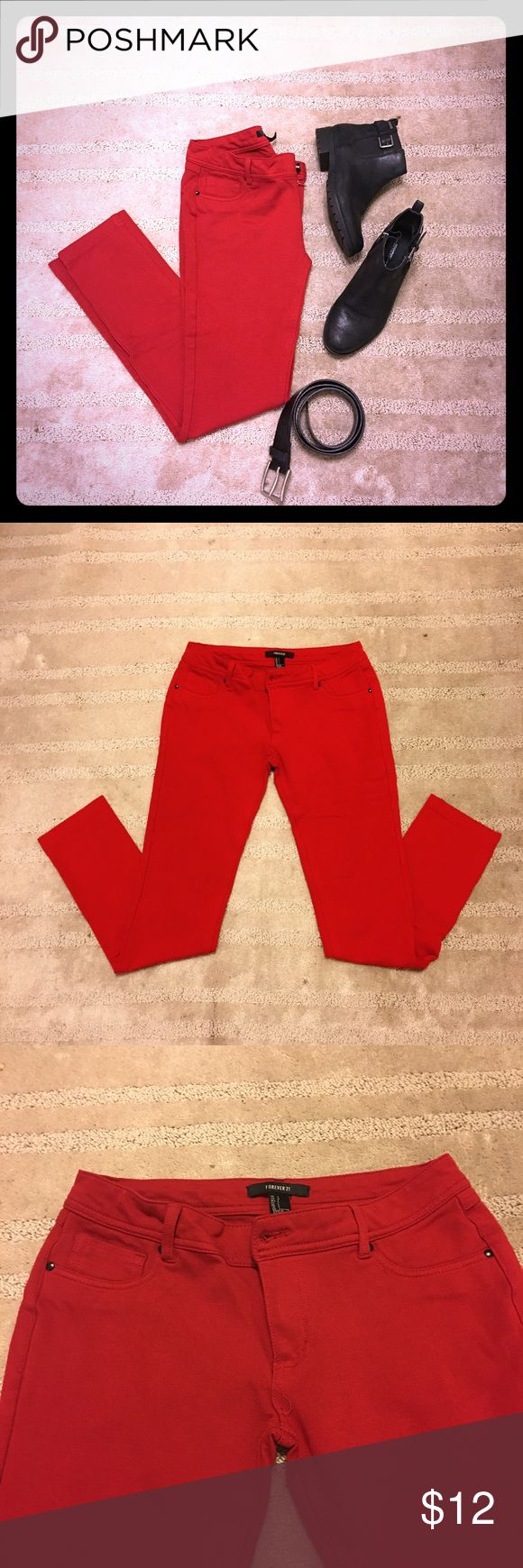 Forever21 Red Stretch Skinny Pants Stretch skinny leggings/pants.  Zip on front with pocket-like design on sides (not real pockets).  Two back pockets (real).  Great with boots and black sweaters or jackets. In very good condition. Size Large but fits like Medium. Forever 21 Pants Skinny