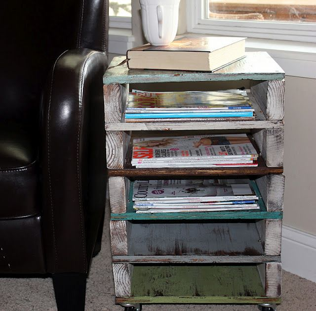 Pallet side table with magazine storage.
