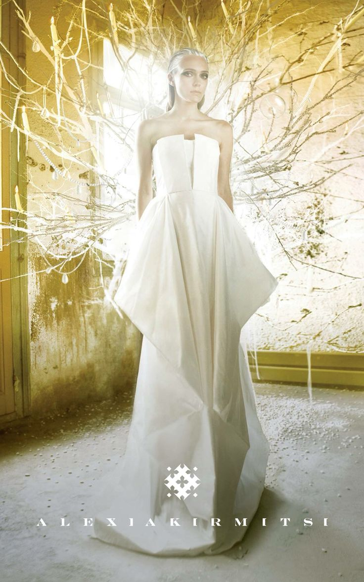 Wedding dress in silk taffeta with volume and geometrical folding 'origami' design. Minimal style. Clean and neat. Abstruct drapes and crisp movement.