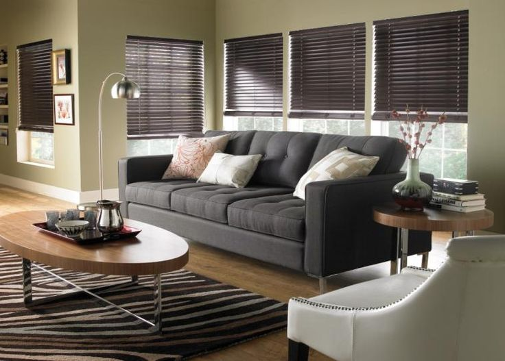 Chocolate Wood Blinds Accent The Dark Hues In This Cozy Living Room