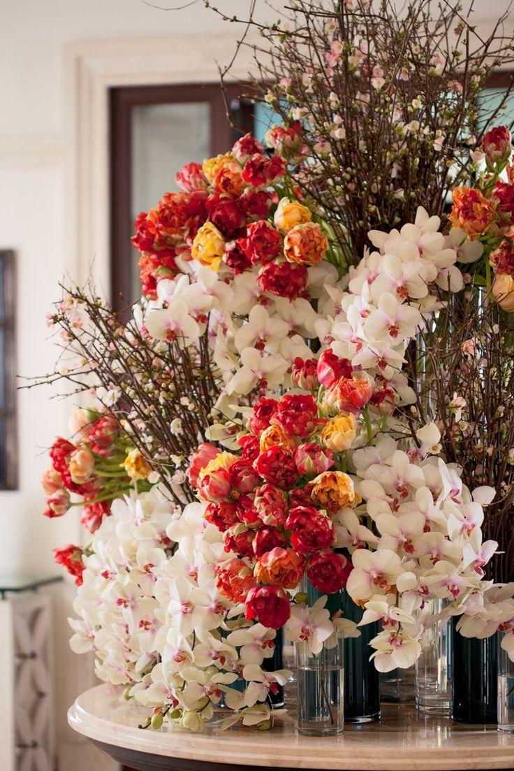 White orchids & orange wild tulips. #flowers   Four ...