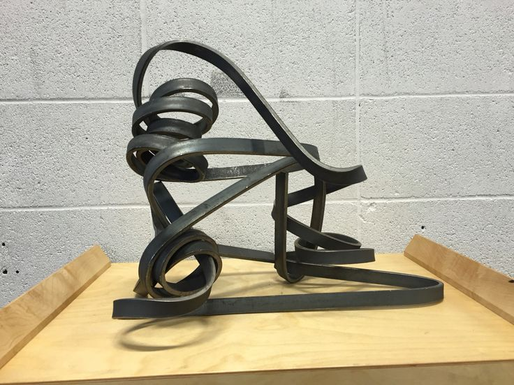 """1/4"""" x 3/4"""" x 20-foot structural steel. Bent by hand without heat or tools. This is a fantastic conversation piece! I'm really looking forward to seeing how it looks after clear coat!"""