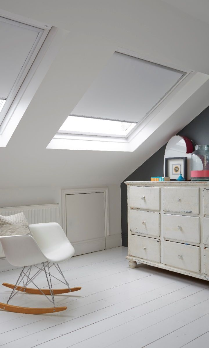 Velux windows and blinds perfect for the bedroom. Lovely vintage and designer mix.