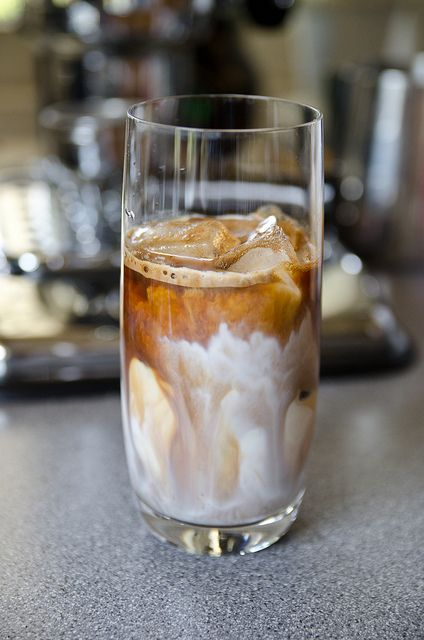 Cuban Ice Latte: Espresso shot with raw sugar in the portafilter, then poured over a glass filled with ice and milk
