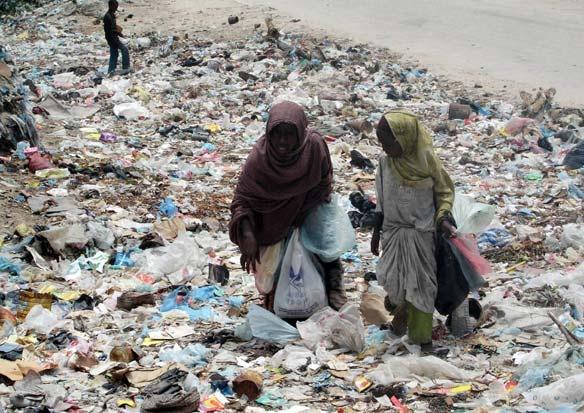 Looking through garbage for food in Mogadishu, Somalia.
