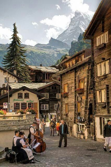 Zermatt, Switzerland...my favorite spot!  Very quaint and colorful flower pots of geraniums everywhere!