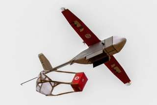 A drone in Rwanda releases a blood package during the visit of Jim Yong Kim of the World Bank Group President.